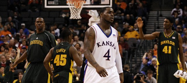 Kansas guard Sherron Collins makes his way from the court during a timeout in the second half Thursday, March 12, 2009 at the Ford Center in Oklahoma City.