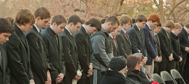 Mourners gather at a memorial service Thursday for Jason Wren in front of the Sigma Alpha Epsilon fraternity house of which he was a member. Wren was found dead Sunday at the fraternity house after a night of drinking, his family has said.
