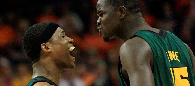 Baylor's Kevin Rogers, left, and Baylor's Mamadou Diene (15) celebrate their 76-70 win over Texas in  an NCAA college basketball game at the Big 12 Conference men's tournament in Oklahoma City, Friday, March 13, 2009.