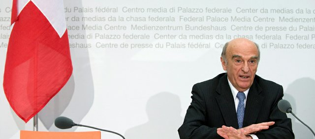 Swiss Federal President Hans-Rudolf Merz, head of the Federal Department of Finance, speaks during a news conference in Bern. The Swiss government said Friday it would cooperate on cases of international tax evasion, breaking with a long-standing tradition of protecting wealthy foreigners accused of hiding billions of dollars in Swiss bank accounts.