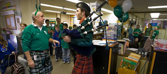 Deerfield School sixth-grade teacher Paul Corcoran, left, who frquently wears a kilt to school in honor of his heritage, was given a little musical surprise Friday from the Deerfield staff. After the bagpipe performance, Corcoran chatted with bagpiper Chris Hannemann.