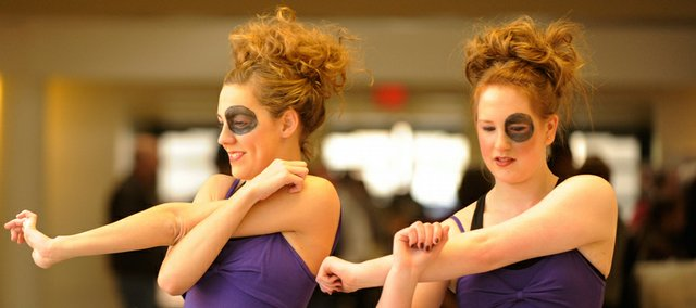 Melissa Gaddis, 16, and Molly Galbrecht, 16, both of Olathe, warm up before their competition early Saturday at the Regional 4-H Day at Lawrence High School. Area 4-H members showed off their skills to judges.
