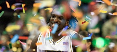Missouri's DeMarre Carroll (1) runs through the confetti after Missouri defeated Baylor in the Big 12 tournament championship game. The Tigers won, 73-60, Saturday in Oklahoma City to claim their first conference championship in 16 years.