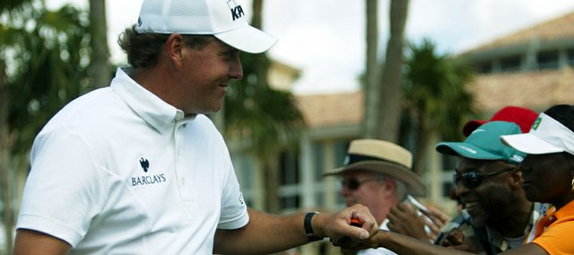 Phil Mickelson is greeted by fans as he heads to the first tee. Mickelson won the CA Championship, despite a case of stomach flu, on Sunday in Doral, Fla. He held off Nick Watney with a 3-under 69 in the final round. It was Mickelson's second victory in his last three starts.