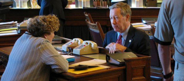 Kansas Senators John Vratil and Vickie Schmidt confer before Senate deliberations on a bill to repeal the death penalty.