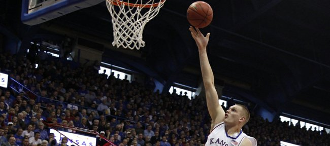 Kansas center Cole Aldrich lays in a bucket over Missouri forward Matt Lawrence and Kansas forward Quintrell Thomas during the second half Sunday, March 1, 2009 at Allen Fieldhouse.