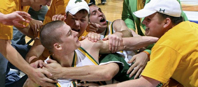 North Dakota State guard Ben Woodside, front, gets stormed by a group of fans after North Dakota State's 66-64 victory over Oakland in the Summit League tournament title matchup on March 10 in Sioux Falls, S.D. Woodside figures to be a tough matchup for Kansas at 11:30 a.m. on Friday in Minneapolis.