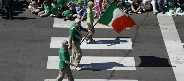 The trio escorting the Irish flag at the head of the 2009 St. Patrick's Day Parade crosses the intersection of Seventh and Massachusetts streets Tuesday in downtown Lawrence.