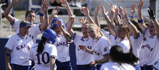 The Kansas dugout clears to congratulate Elle Pottorf, 10, after Pottorf's third-inning two-run home run against Western Illinois Tuesday, March 17, 2009 at Arrocha Ballpark.