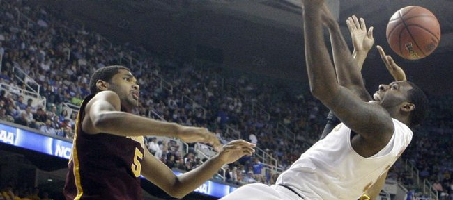 Texas' Damion James, right, is fouled by Minnesota's Devoe Joseph, left, during the second half of a first-round men's NCAA college basketball tournament game in Greensboro, N.C., Thursday, March 19, 2009.