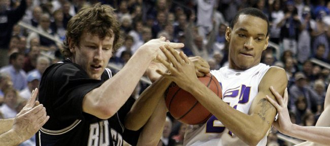 Butler's Matt Howard (54) and LSU's Chris Johnson (21) wrestle for control of the ball during the second half of a first-round men's NCAA college basketball tournament game in Greensboro, N.C., Thursday, March 19, 2009.