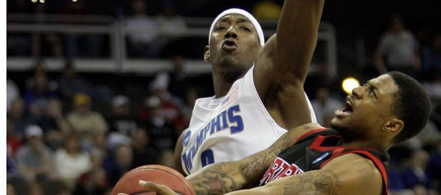 Memphis' Robert Dozier, left, gets above Cal State Northridge's Mark Hill (3) to block his shot in the first half during a first-round game at the men's NCAA college basketball tournament in Kansas City, Mo., Thursday, March 19, 2009.