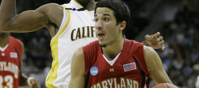 Maryland's Greivis Vasquez (21) works the ball around California's Patrick Christopher (23) in the first half during a first-round men's NCAA college basketball tournament game in Kansas City, Mo., Thursday, March 19, 2009.