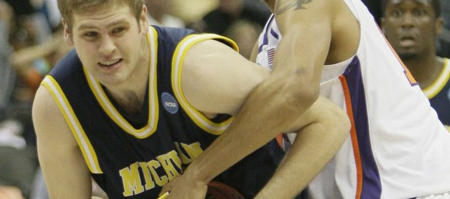 Michigan's Zack Gibson, left, and Clemson's David Potter fight for control of the ball in the second half during a first-round men's NCAA college basketball tournament game in Kansas City, Mo., Thursday, March 19, 2009.