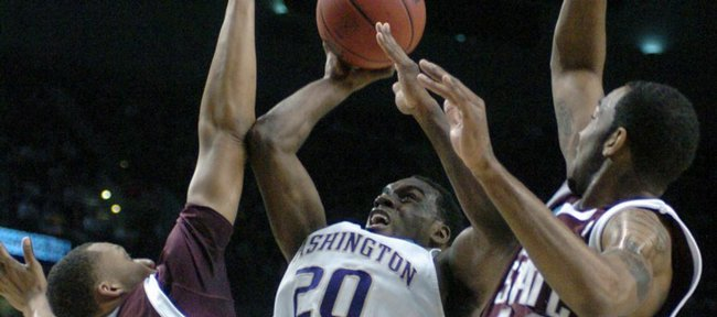 Washington's Quincy Pondexter (20) shoots against Mississippi State's Kodi Augustus (24) and Brian Johnson (44) during the first half of a first round men's NCAA basketball tournament game in Portland, Ore., Thursday, March 19, 2009.