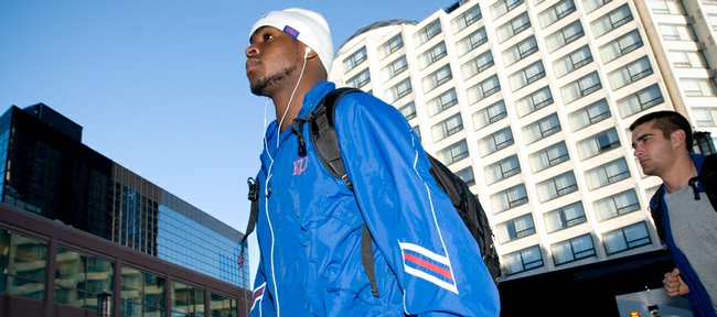 Kansas guards Sherron Collins, center, and Brennan Bechard make their way to the Hyatt Regency hotel upon their arrival Wednesday in Minneapolis.