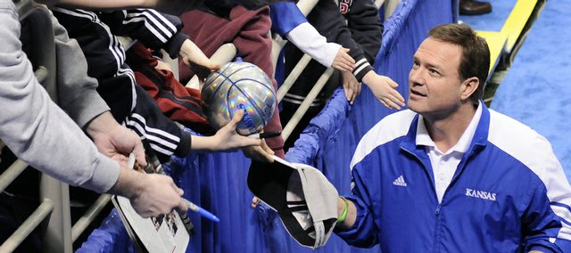 Kansas head coach Bill Self signs autographs for kids as the Jayhawks leave the court following practice Thursday, March 19, 2009 at the Metrodome in Minneapolis.