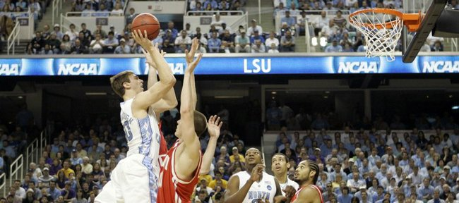 North Carolina's Tyler Hansbrough, left, shoots over Radford players during the first half of a first-round men's NCAA college basketball tournament game in Greensboro, N.C., Thursday, March 19, 2009.