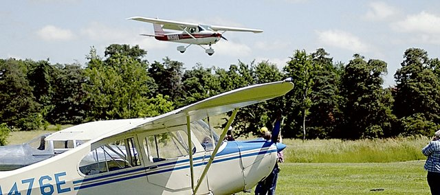 A plane lands at the Vinland Airport during a Planes, Trains and Automobile event several years ago in this file photo. The grass runway at the airport will receive a $44,504 upgrade after the Kansas Department of Transportation agreed to cover three-fourths of the cost.