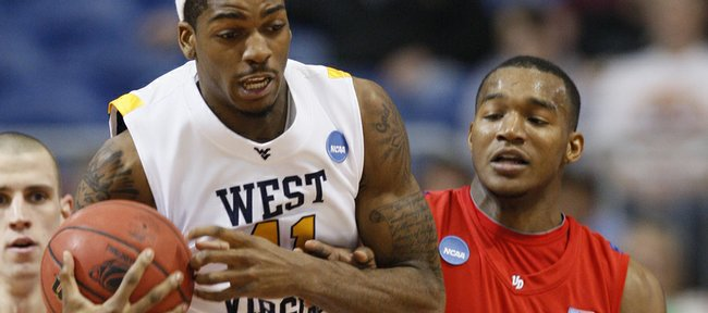 West Virginia's John Flowers (41) and Dayton's Chris Wright (33) go after a rebound during a first-round men's NCAA college basketball tournament game, Friday, March 20, 2009, in Minneapolis.
