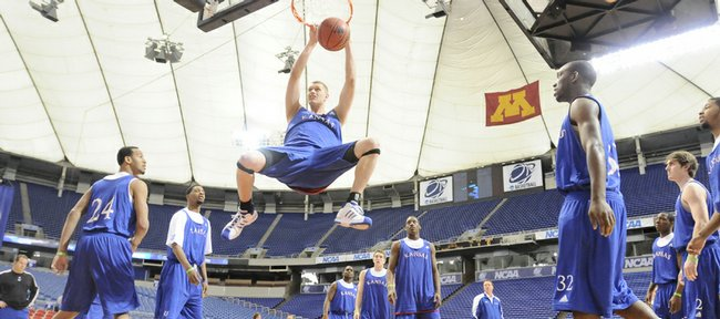 Kansas center Cole Aldrich delivers a dunk to start practice after the Kansas University basketball team worked through a weave on Thursday at the Metrodome. The Jayhawks, 91⁄2-point favorites today in the first round of the NCAA Tournament, will take on North Dakota State at 11:30 a.m. in Minneapolis.