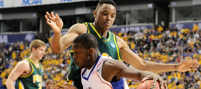 Kansas forward Mario Little drives to the bucket against North Dakota State forward Dejaun Flowers during the first half Friday, March 20, 2009 at the Metrodome in Minneapolis.