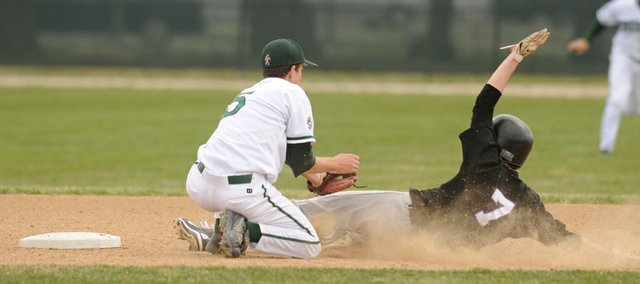 Free State second basemen Tyler Hatesohl, left, puts the tags on BV Northwest's Blake Heenan in the third inning. The Firebirds won their season-opener, 2-1, on Friday at Ice Field.