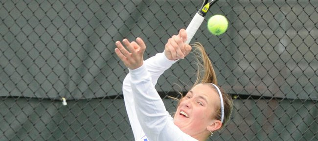 Kansas University's Edena Horvath returns a serve against Colorado on Friday at First Serve Tennis Center.