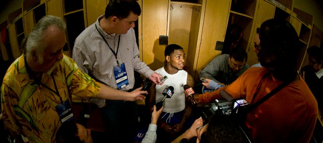 Kansas junior guard Sherron Collins is surrounded by media members in the Jayhawks' locker room on Saturday at the Metrodome in Minneapolis. Collins, who most KU players call their team leader, has gotten off to a stellar start so far in the NCAA Tournament.
