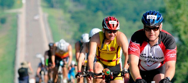 Athletes crest a hill in western Douglas County during the Ironman 70.3 Kansas triathlon in this June 15, 2008, file photo at Clinton Lake.  The event will return to Lawrence for its second year on June 14.