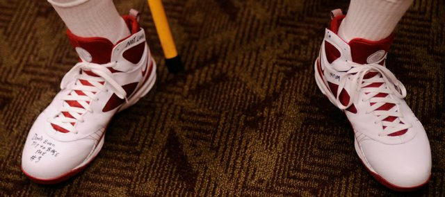 Dayton guard Mickey Perry has several bits of inspiration and warnings to his competitors written on his shoes.