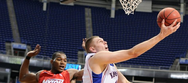 Kansas center Cole Aldrich hooks a shot underneath the bucket past Dayton defenders Chris Wright, left, and Charles Little during the second half Sunday March 22, 2009 at the Metrodome in Minneapolis.