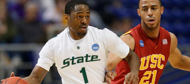 Michigan State's Kalin Lucas (1) tries to drive on usc's Dwight Lewis on Sunday in Minneapolis.