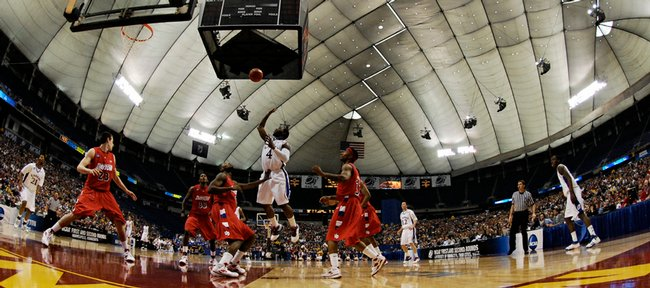 Kansas guard Sherron Collins floats a shot over the Dayton defense during the first half Sunday March 22, 2009 at the Metrodome in Minneapolis.