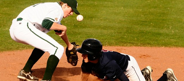 Free State's Hayden Emerson, left, tries to make a play at first on St. James Academy's Jake Wodthe. The Firebirds beat the Thunder, 4-3, Monday at Hoglund Ballpark.
