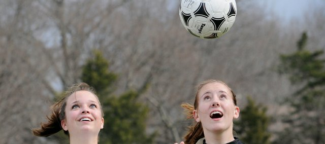 Senior soccer players Heather Miller, of Lawrence High, left, and Free State's Courtney Moore will lead their teams into the spring soccer season, which begins today for FSHS.