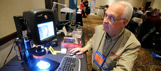 Law enforcement personnel from the area are in Lawrence for a two-day conference put on by the International Association for Identification at the Spring Hill Suites by Marriott at 1 Riverfront Plaza. Vendors including Jerry Kramper of Forensics Source were on hand to show off some of the latest technology on Tuesday.