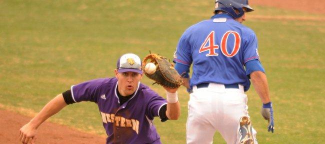 Kansas University's Nick Faunce beats the throw to Western Illinois first baseman Tyler Metcalf. KU won, 7-4, on Wednesday at Hoglund Ballpark.
