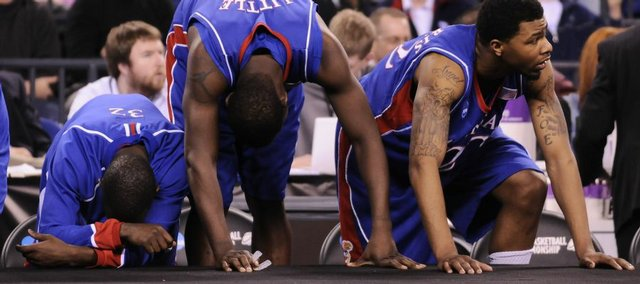 Kansas players, from left, Tyrone Appleton, Mario Little and Marcus Morris can't watch the final moments of the Jayhawks' loss to Michigan State during the second half Friday, March 27, 2009 at Lucas Oil Stadium in Indianapolis.