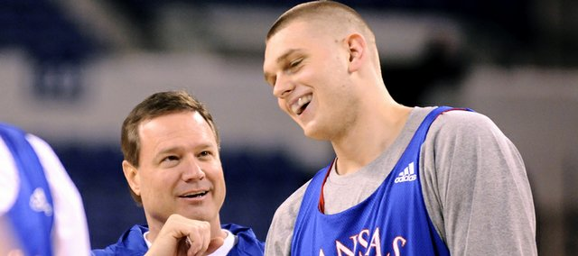 Kansas head coach Bill Self and center Cole Aldrich laugh during practice Thursday at Lucas Oil Stadium in Indianapolis.