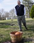 Randy Towner visits the Lawrence Memorial Park gravesite of James Naismith, the inventor of basketball, Wednesday, March 25, 2009. Towner used to run with a group including KU coach Roy Williams, who would often stop by the Naismith gravesite for a little luck before KU basketball games.