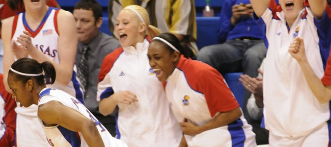The KU bench cheers after a basket by Danielle McCray against Arkansas Thursday, March 26, 2009, at Allen Fieldhouse.