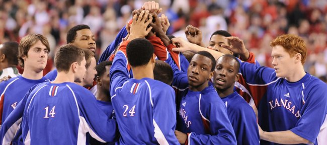 Members of The Kansas University men's basketball team come together for a huddle before taking on Michigan State on Friday at Lucas Oil Stadium in Indianapolis. KU coach Bill Self said he wouldn't mind a return trip to Indianapolis next year — for the Final Four.