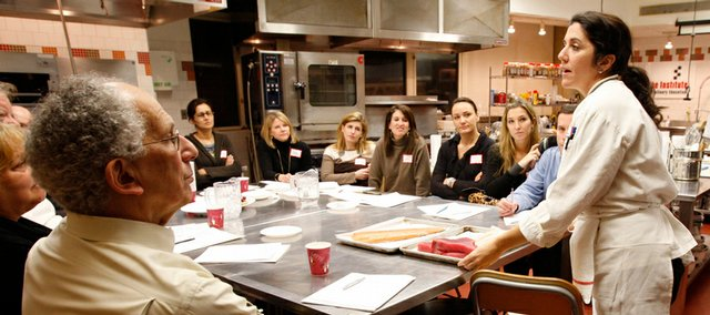 Chef instructor Sabrina Sexton, right, explains about choosing fresh fish to students in a recreational class on preparing quick and easy sauces for fish Feb. 25 at the Institute of Culinary Education in New York.