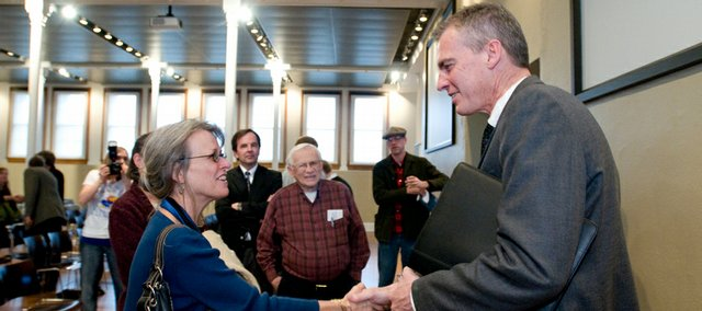Lt. Gov. Mark Parkinson introduces himself to Saralyn Reece Hardy, director of the Spencer Museum of Art, after his talk on climate change Tuesday at Kansas University.