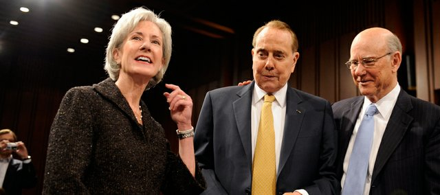 Kansas Gov. Kathleen Sebelius, from left, stands with former Senate Majority Leader Bob Dole and Sen. Pat Roberts, R-Kan., Tuesday in Washington, D.C., before the start of her confirmation hearing before the Senate Health, Education, Labor and Pensions Committee. Sebelius is President Barack Obama's choice to lead the U.S. Department of Health and Human Services.