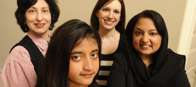 From left, Eve Levin, Ammaarah Haq, Danielle Price and Asra Haq will attend a Women's Seder at Lawrence Jewish Community Center.