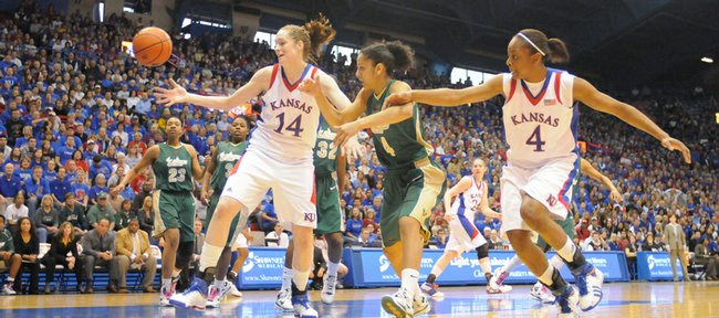 KU's Krysten Boogaard goes for a rebound against South Florida's Jazmine Sepulveda in the second half of the WNIT championship game at Allen Fieldhouse. USF won the game, 75-71.