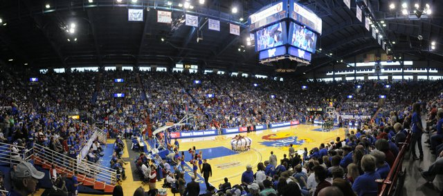 A crowd of more than 16,000 basketball fans watch the women's Kansas University basketball team prepare to take on the South Florida bulls in the WNIT championship game Saturday in Allen Fieldhouse. The crowd was the largest ever to watch a KU women's game in the fieldhouse.