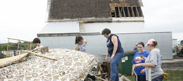 Residents walk past tornado-damaged homes in Chapman. Tornadoes raked Kansas on June 11, 2008, killing at least two people, destroying much of the small town of Chapman and causing extensive damage on the Kansas State University campus in Manhattan.